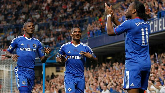 Didier Drogba applauds Florent Malouda for his goal against Birmingham