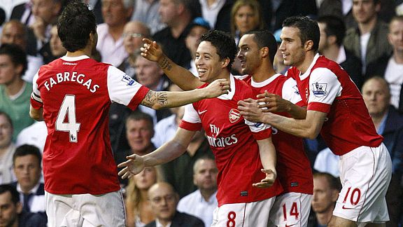 Theo Walcott celebrates his goal with his team-mates