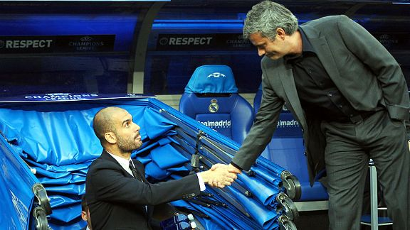 Pep Guardiola and Jose Mourinho shake hands before kick-off.