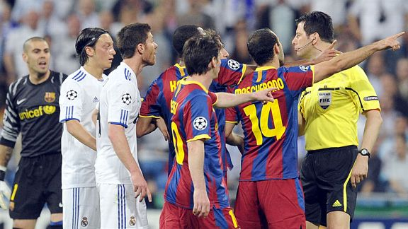 Barcelona players, led by Javier Mascherano, hound referee Wolfgang Stark.