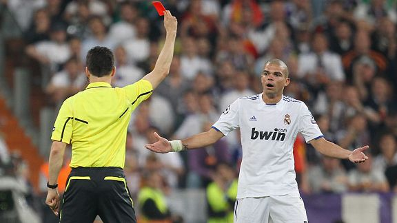 Pepe is sent off by referee Wolfgang Stark for a high tackle on Dani Alves.