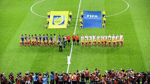The teams hear their respective national anthems on the pitch in Frankfurt
