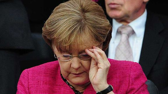 Birthday girl: German chancellor Angela Merkel gets her glasses on