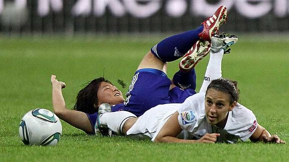 Floored in Frankfurt: Shinobu Ohno and Carli Lloyd hit the deck