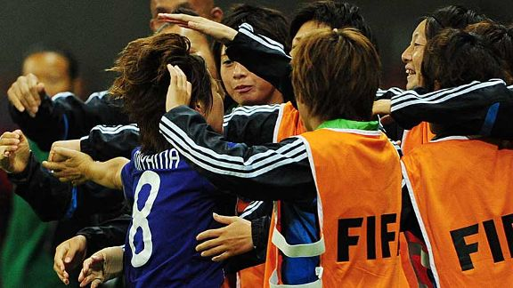 Rising sun strikes: Japan's players and staff celebrate Aya Miyama's equaliser