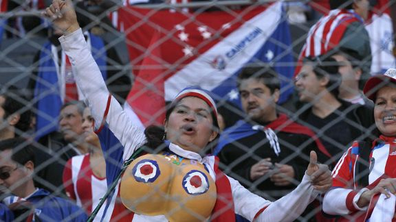 A Paraguay fan gets into the spirit ahead of the kick-off