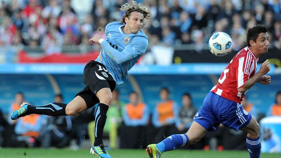 Diego Forlan fires home to put Uruguay into a 2-0 lead