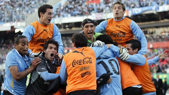 Uruguay celebrate after Diego Forlan's late goal made it 3-0