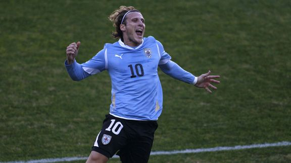 Diego Forlan celebrates after doubling Uruguay's advantage