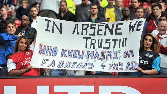 Arsene Wenger banner Man Utd v Arsenal