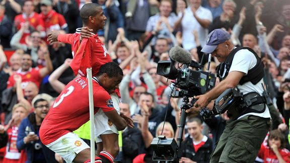 Ashley Young celebrates after making it 2-0 to Manchester United