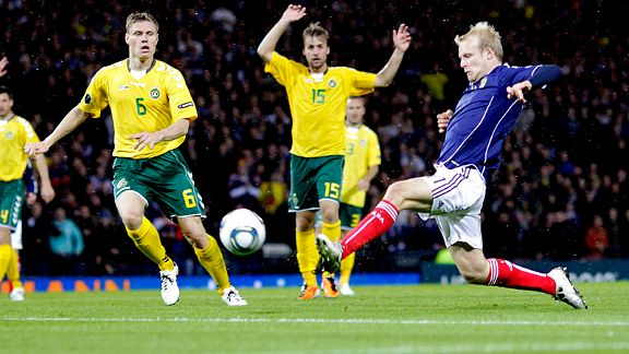 Scotland's Steven Naismith scores the winning goal against Lithuania