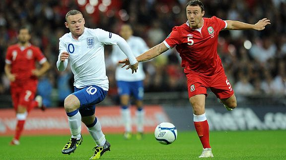 Wales' Darcy Blake and England's Wayne Rooney battle for the ball