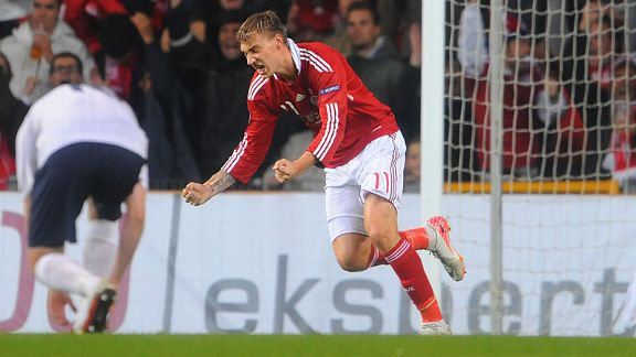 Denmark's Nicklas Bendtner celebrates one of his two goals against Norway.