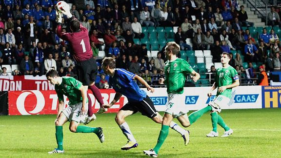 Northern Ireland's Lee Camp makes a save against Estonia.