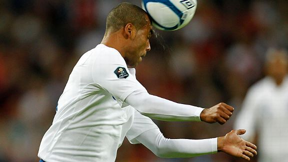 England's Ashley Cole sweats as he heads the ball clear