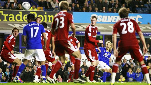 Phil Neville scores to put Everton into the next round