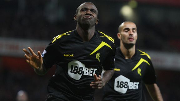 Fabrice Muamba celebrates after putting Bolton into the lead at Arsenal
