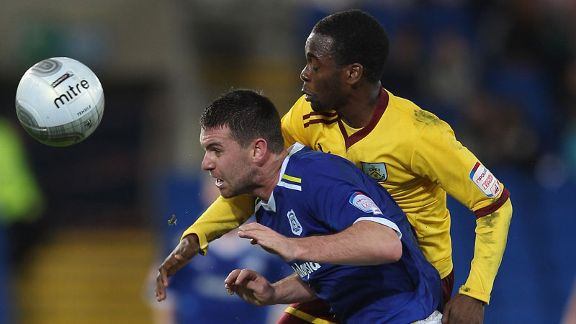 Anthony Gerrard and Zavon Hines battle for possession at the Cardiff City Stadium