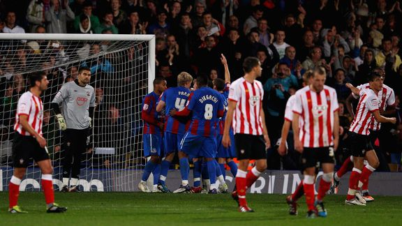 Crystal Palace celebrate after Jermaine Easter's late penalty rounded off the victory
