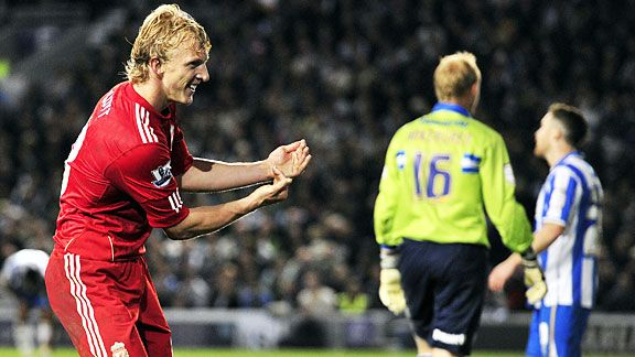 Dirk Kuyt celebrates after firing Liverpool's crucial second