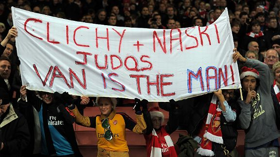 Arsenal fans hold up a banner berratting former players Clichy and Nasri