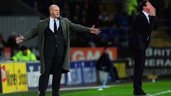 Blackburn manager Steve Kean and Malky Mackay look on during the Carling Cup quarter final