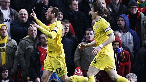 Glenn Murray (l) celebrates after his extra-time winner at Manchester United.