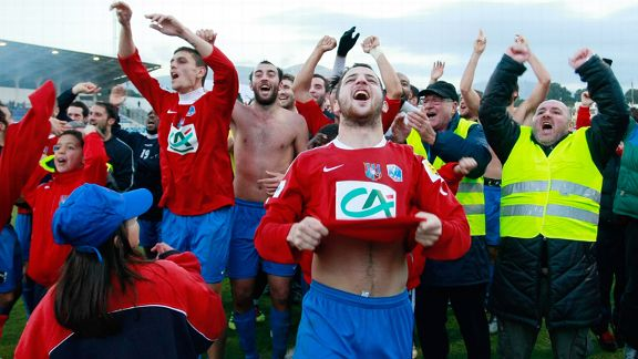 Ajaccio's players celebrate their defeat of Toulouse in the French Cup