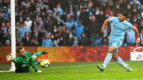 Sergio Aguero pounces on an Anders Lindegaard error to make it 2-3