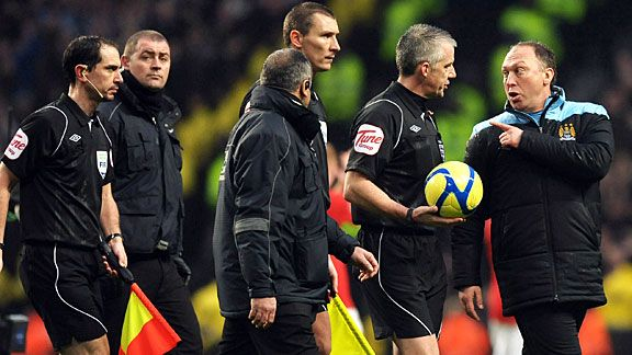 David Platt complains to referee Chris Foy about his handling of the Manchester derby.