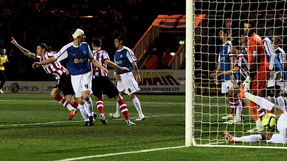 James McLean (l) celebrates after scoring Sunderland's second at Peterborough United.