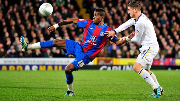Crystal Palace striker Wilfried Zaha vies with Cardiff City defender Andrew Taylor