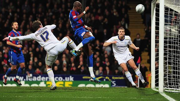 Anthony Gardner of Crystal Palace scores with a header
