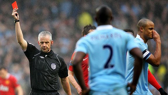Chris Foy gives Vincent Kompany (r) his marching orders for a two-footed tackle on Nani.