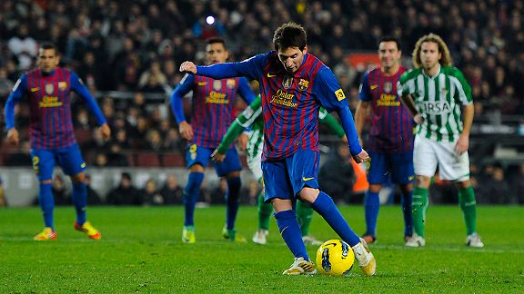 Lionel Messi scores Barcelona's fourth goal from the penalty spot