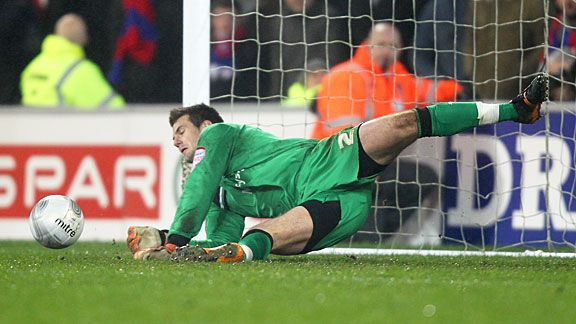 Tom Heaton gets down low to his right to keep out Sean Scannell's spot-kick.