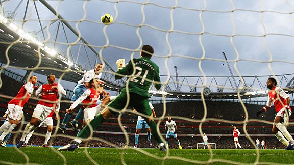 Lukasz Fabianski is powerless to stop Richard Dunne's header finding the back of the net.