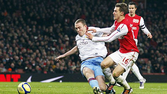 Richard Dunne brings down Aaron Ramsey, giving Arsenal a route back into the FA Cup tie.