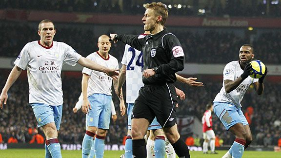 Darren Bent insists he won the ball as Mike Jones points to the spot for Arsenal's decisive penalty.