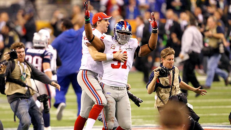 Justin Tuck and Eli Manning