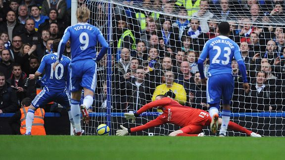Colin Doyle of Birmingham City saves a penalty from Juan Mata of Chelsea