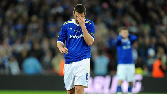 Anthony Gerrard shows his frustration after missing the decisive penalty