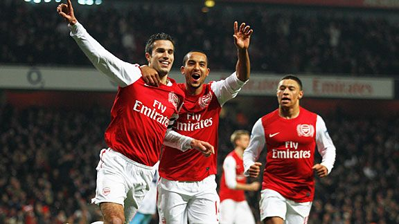 Robin van Persie and Theo Walcott celebrate after one of their spot-kicks against Villa.