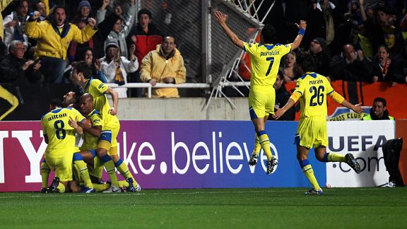 Apoel's players celebrate Gustavo Manduca's goal against Lyon.