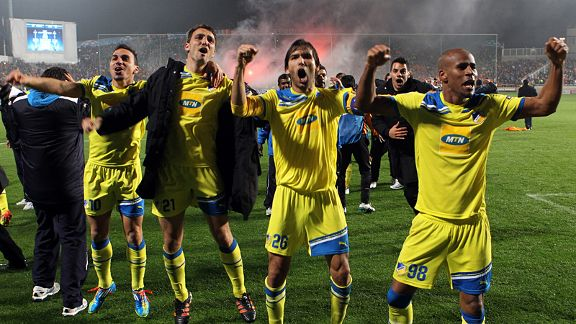 APOEL players celebrate after beating Lyon on penalties