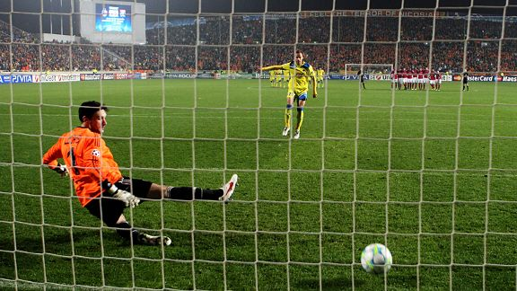 APOEL's Nektarios Alexandrou scores past Lyon's goalkeeper Hugo Lloris during the penalty shootout.
