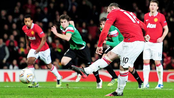 Wayne Rooney scores from the spot to give United hope.
