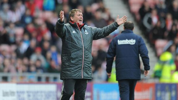 Kenny Dalglish shows his frustration on the touchline as Liverpool slump to defeat at Sunderland