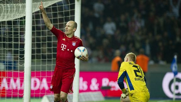 Arjen Robben celebrates after completing his hat-trick